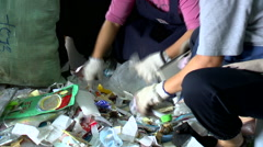 People sorting garbage for recycling Stock Footage