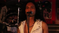 Thai singer sings the song of Dire Straits at the bar on a Walking Street. Stock Footage