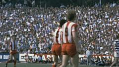 Bundesliga 1970s match: Bayern Munich angry with his playmate Stock Footage