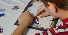 Child Hands Assemble Jigsaw Puzzle 4k Stock Footage