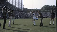 Bundesliga 1970s match: filmakers shooting the game Stock Footage