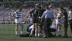 Bundesliga 1970s match: player injured Stock Footage