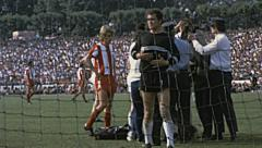 Bundesliga 1970s match: injured player Stock Footage