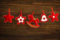 Christmas decoration hanging toy, grunge wooden background, grain brown wood Stock Photos