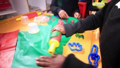 Kids playing with plasticine Stock Footage