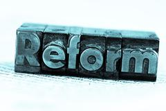 written reform in lead letters - stock photo