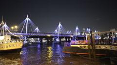 Fantastic night shot of the Golden Jubilee Bridge in London - stock footage