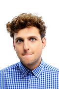 Stock Photo of funny young man with curly hair on white background