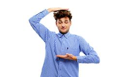 funny young man gesturing with his hands on white background - stock photo