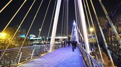 Golden Jubilee Bridge by night pedestrian walkway Stock Footage