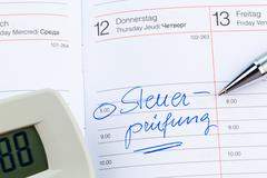 Entry in the calendar: tax audit Stock Photos