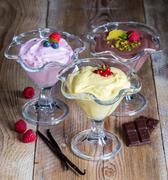Dessert variation chocolate cream raspberry cream vanilla cream Stock Photos