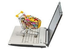 tablets with shopping cart and computer - stock photo