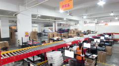 Express delivery industry distributing packages on assembly line Stock Footage