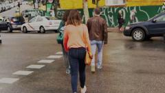 Pedestrians crossing street in the city, steadycam shot Stock Footage