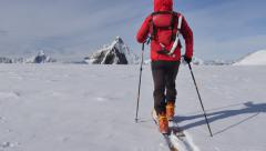 Mountaineer walking on a glacier during a winter expedition in the european Alps - stock footage