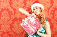 Stock Photo of woman holding a gift