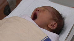 Newborn baby waking up and looking around Stock Footage