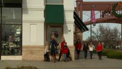 Young Women and Children Holiday Shopping Stock Footage