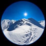 fisheye lens image of negoiu peak in winter - stock photo
