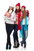 Three girls in winter clothing showing credit cards Kuvituskuvat