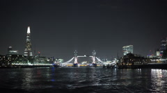 The Skyline of London by night with Tower Bridge and Shard Stock Footage
