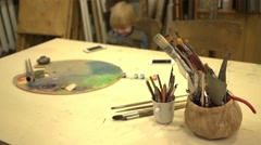 Stock Video Footage of Smart little boy 2 years old at drawing lesson with cell phone