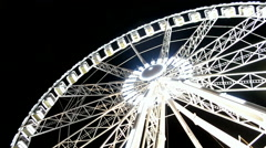 Giant wheel attraction in Paris on black sky. Stock Footage