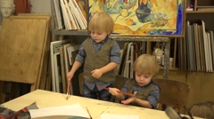 Twins boys 2 years old at drawing lesson - stock footage
