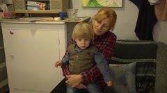 Cute little boy with senior grandmother Stock Footage