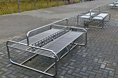 modern metal benches in the style of hi-tech - stock photo