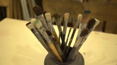 Paint brushes in the pot on the table at drawing lesson Stock Footage