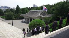 Politicians News Media Reporters Walk Down Stairs Chungnyeolsa Korean Shrine 4K Stock Footage