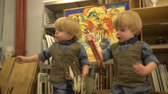 Twins boys 2 years old at drawing lesson Stock Footage