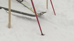 Close up of skis leaving the race starting gate Stock Footage