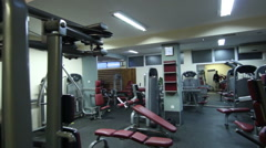 Local fitness center studio equipment. Steady cam shot - stock footage