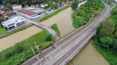 Flying over river and railway with flooded road under Stock Footage