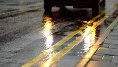 Car lights reflecting in the rain Stock Footage