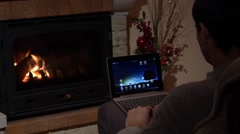 Man Is Using Skype On A Laptop In Front Of A Fireplace Communication Concept Stock Footage