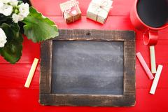 Blank chalkboard on red table Stock Photos