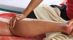 Woman makes a man foot massage on the beach. Koh Samui in Thailand.  hear sounds Stock Footage