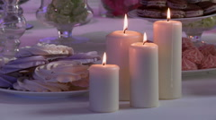 View of white candles on dessert table Stock Footage
