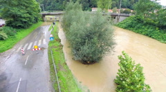 Ascending over flooding river and closed road Stock Footage