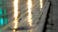 Car lights reflecting on wet road in the rain Arkistovideo