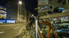Bicycle stand at night in front of an event site time lapse 4K Stock Footage