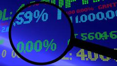 Magnifying glass on stock market ticker Stock Footage