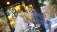 Bride and groom kissing in caffee tilt shot Stock Footage