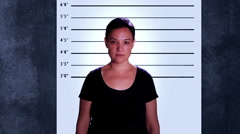 Woman getting her mugshots - stock footage