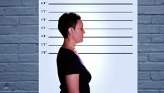 Stock Video Footage of Woman getting her mugshots II