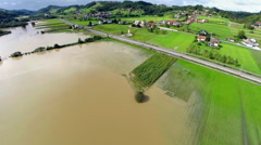 Heavy flood in lower grounds around river - stock footage